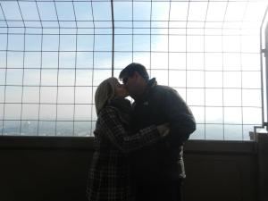 A kiss on top of the Tour de Eiffel (Eiffel Tower, for you non-French speakers).